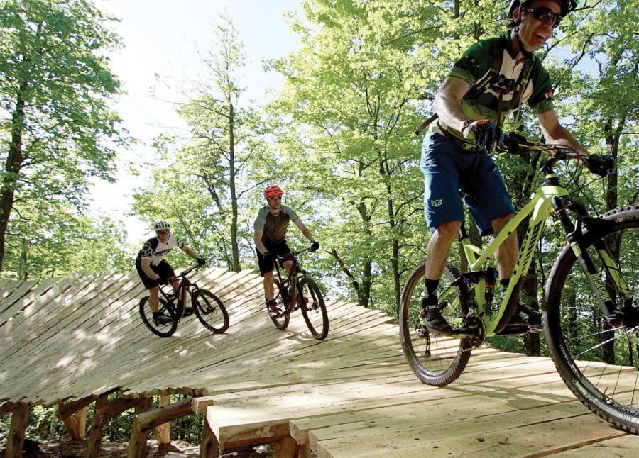 People riding mountain bikes at Detroit Mountain Recreation Area in Detroit Lakes, MN.