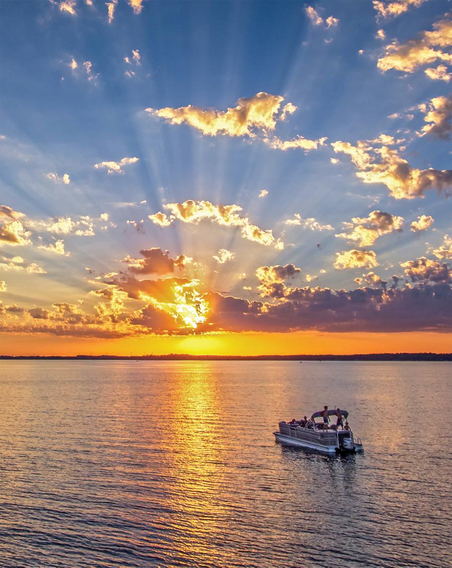 A pontoon on Detroit Lake at sunset in Detroit Lakes, MN.