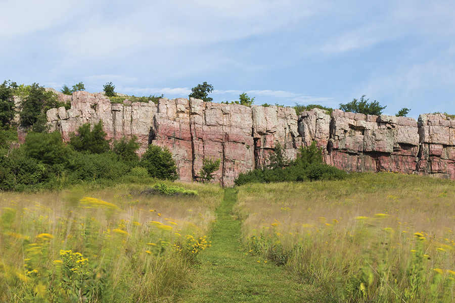 A grass walking path leads up to rocks at Blue Mounds State Park in Luverne, Minnesota.