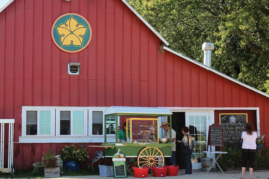 Visitors buying treats at Squash Blossom Farm.