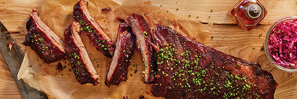 A cutting board of Revival's butter ribs, part of the best barbecue in Minnesota.