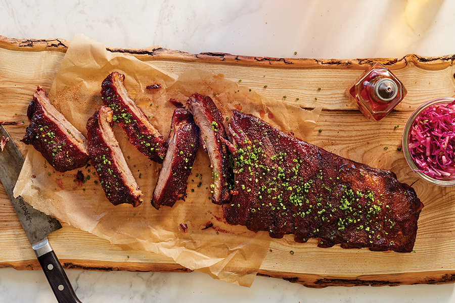 A cutting board with Revival's butter ribs.