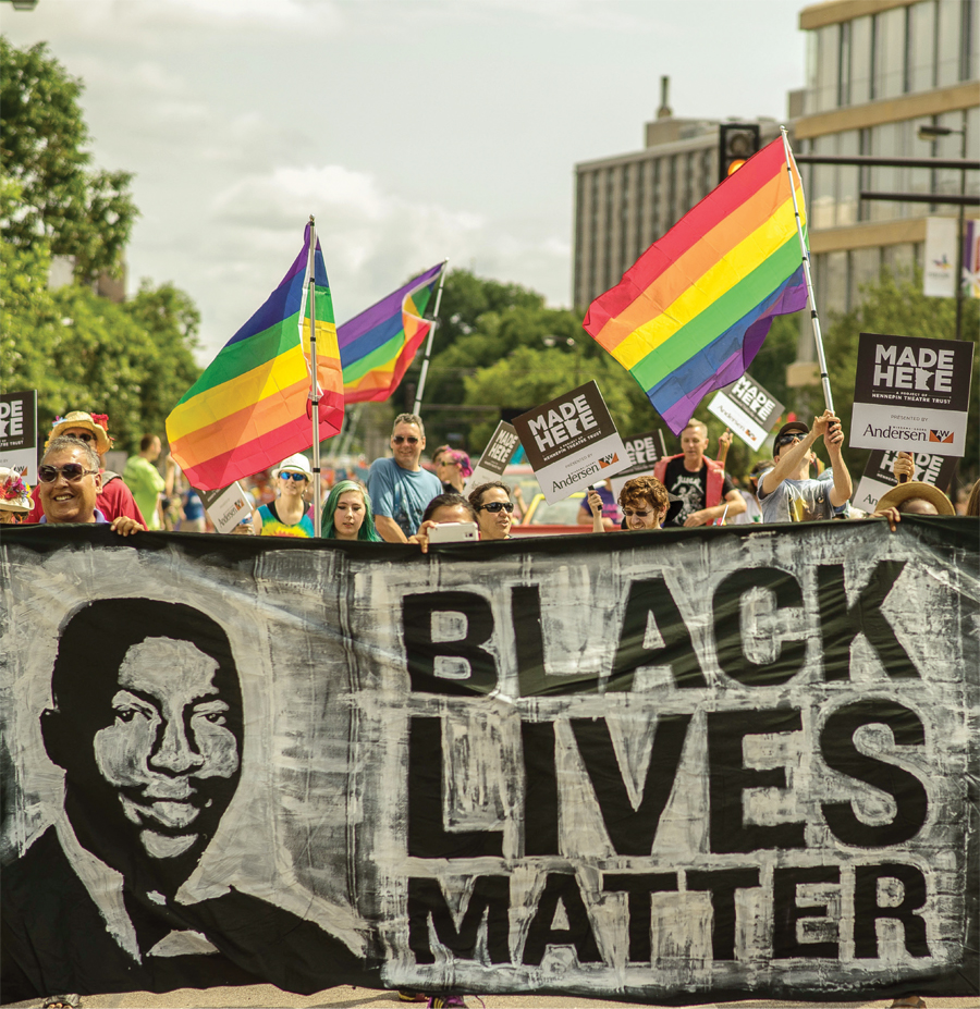 People holding a Black Lives Matter banner at the Twin Cities Pride parade.