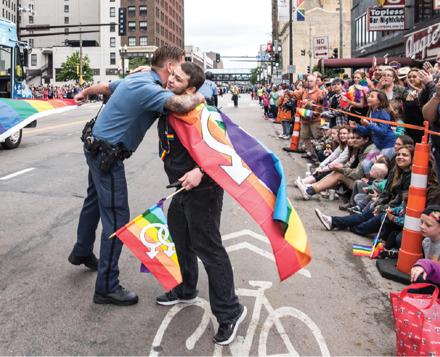 A police officer hugging an attendee at the Twin Cities Pride parade.