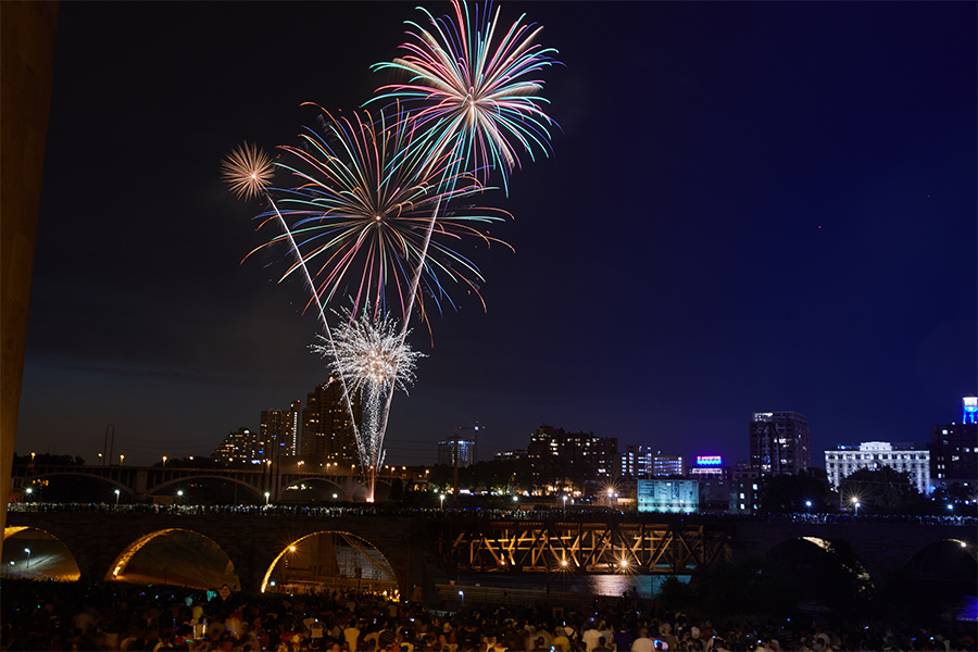 Fourth of July fireworks over the Stone Arch Bridge at Red, White and Boom in Minneapolis, Minnesota.