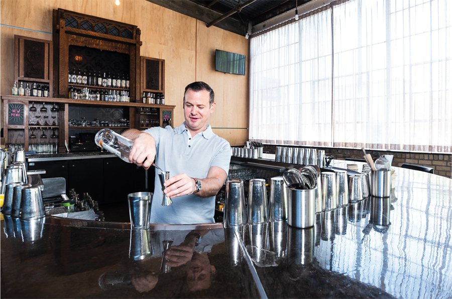 Tattersall founder Dan Oskey mixing cocktails.