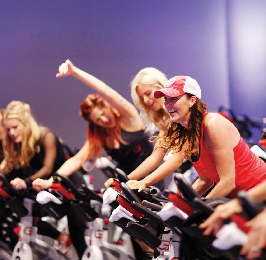Women riding cycles at a spin class at Cyclebar.