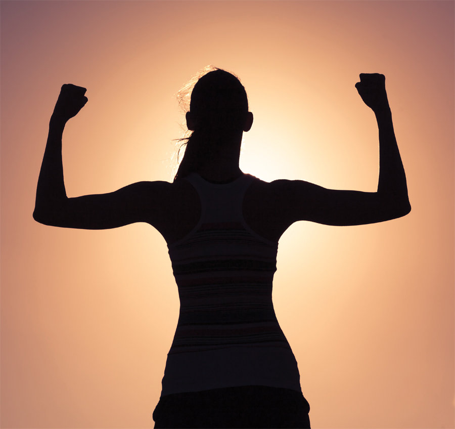 A silhouette of a woman flexing.