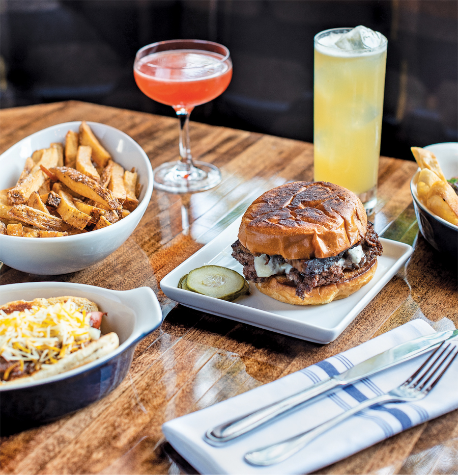 Chili dog, double-bacon Parlour Burger, and fries with Going Dutch and Oaxacan Hard cocktails at Parlour in St. Paul.