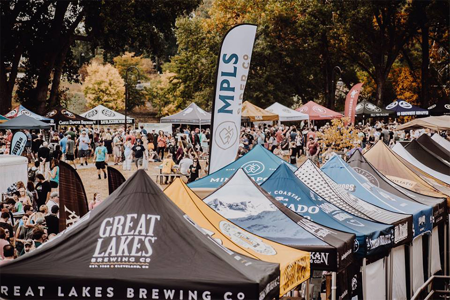 A collection of beer tents and a crowd of people at All Pints North.