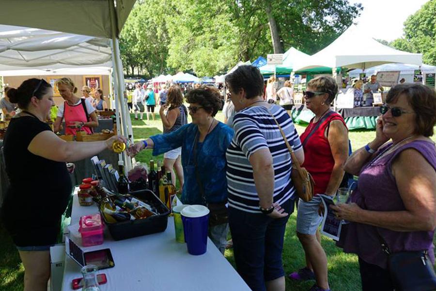 People tasting wine at the Cannon Falls Wine & Art Fest.