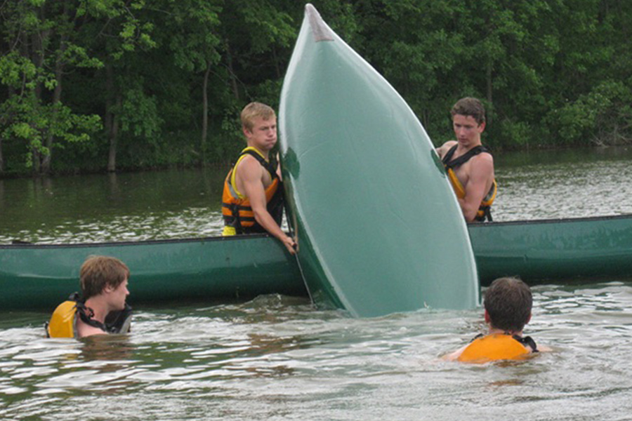 A group of boys canoeing.