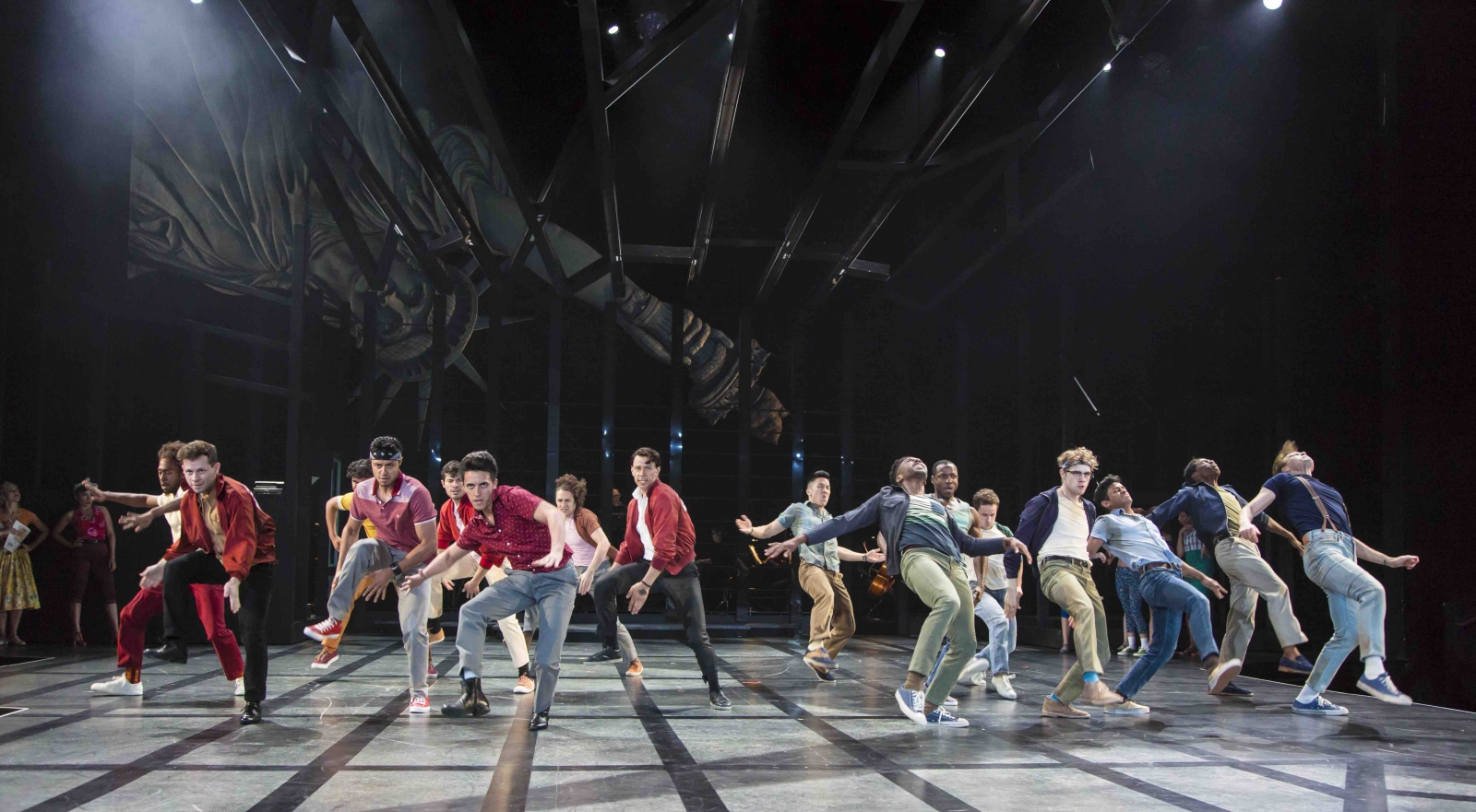 The cast of the Guthrie Theater's production of West Side Story, based on a conception of Jerome Robbins with a book by Arthur Laurents. Music by Leonard Bernstein, lyrics by Stephen Sondheim, directed by Joseph Haj. Scenic design by Christopher Acebo, costume design by Jen Caprio, lighting design by Bradley King, sound design by Elisheba Ittoop. June 16 — August 26, 2018 on the Wurtele Thrust Stage at the Guthrie Theater, Minneapolis. Photo by T Charles Erickson.