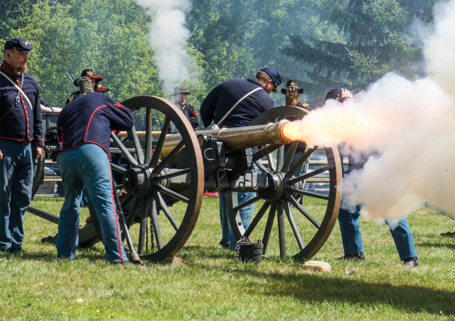People shooting a cannon at Pipestone Civil War Days.