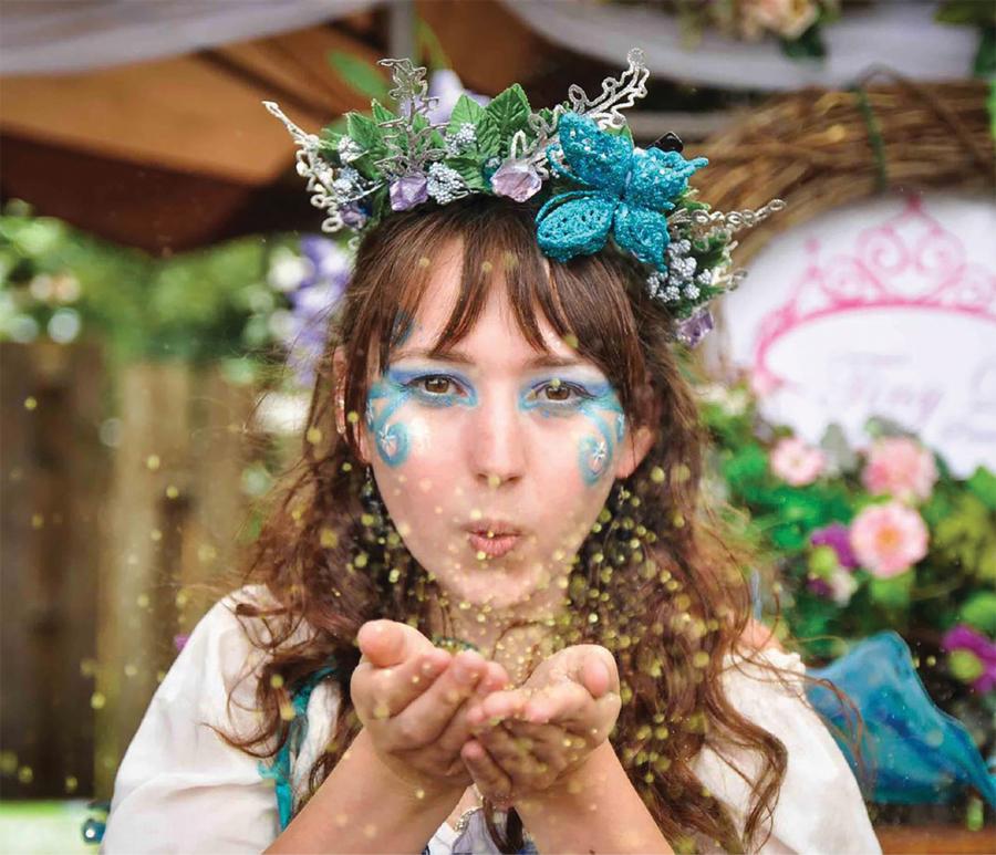 A fairy blowing pixie dust at the Minnesota Renaissance Festival.