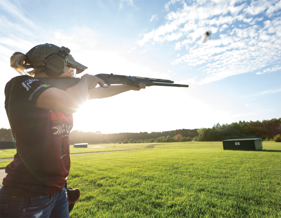 Dakota Overland takes aim during trap shooting.
