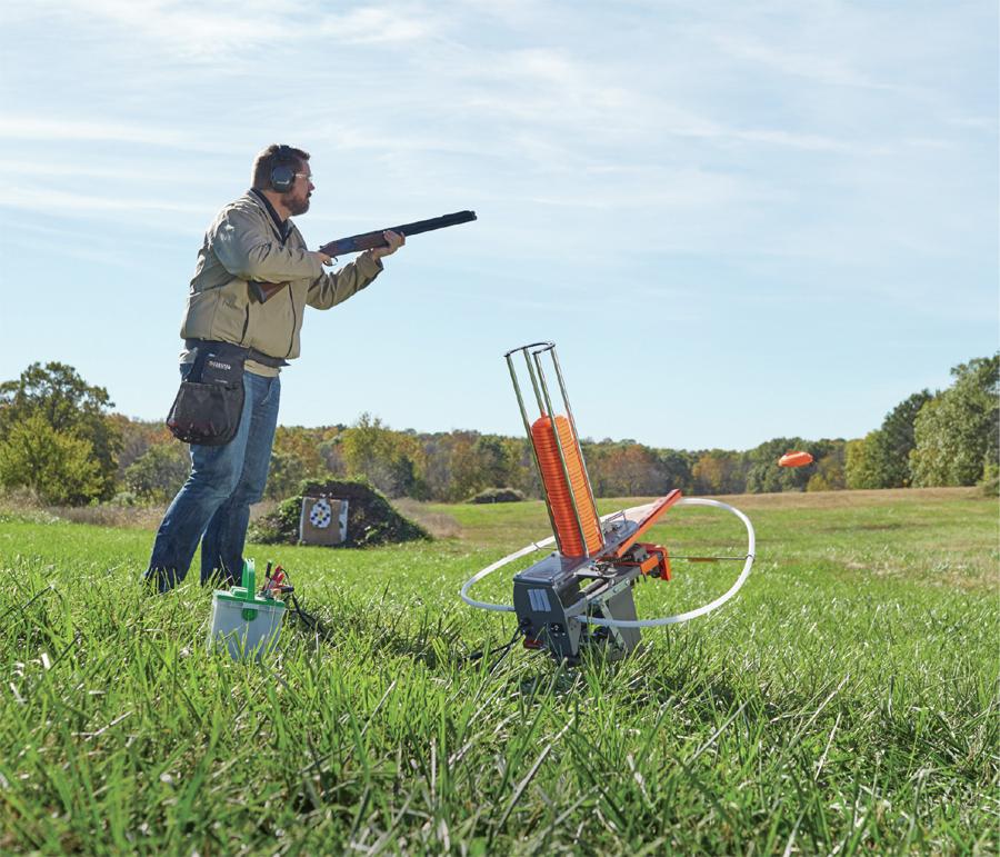 A man shooting trap using a Wheelybird 2.0 Mobile Trap.