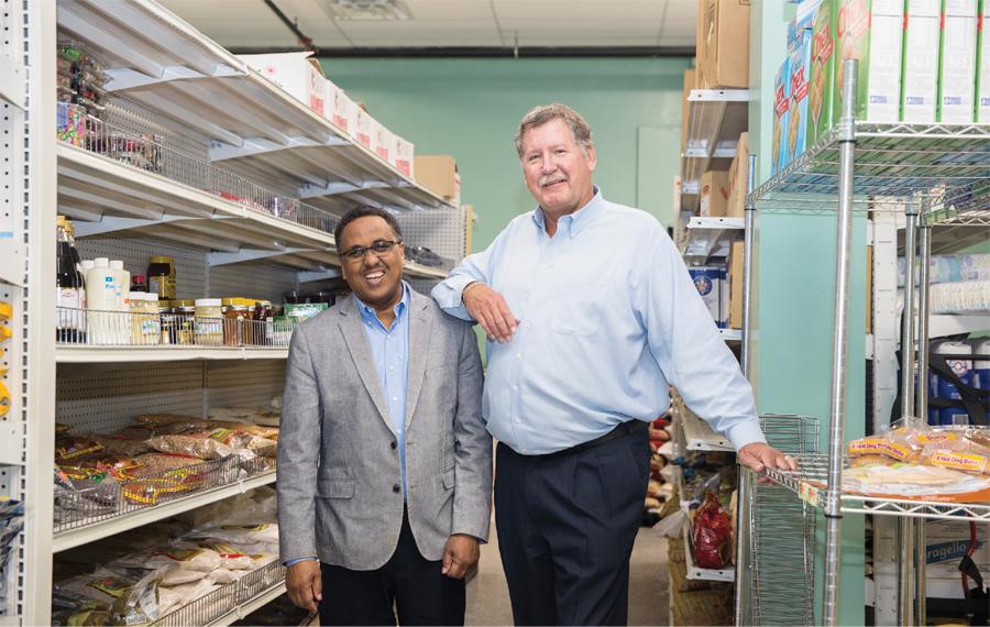Zack Mahboub and Ken Warner standing in a store aisle in Willmar, Minnesota.