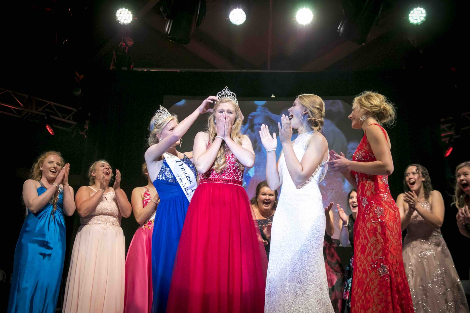 Haley Hinrichs, the 63rd Princess Kay of the Milky Way, crowning Emily Annexstad at the 2017 Princess Kay coronation. Photo by Matt Addington.