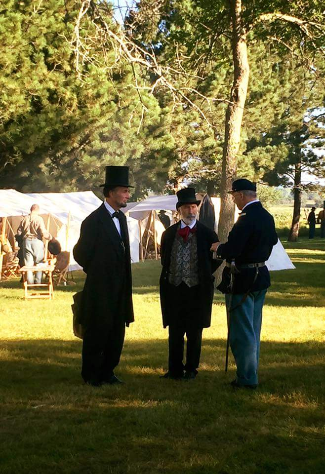 Men dressed in suits during a reenactment of the Civil War at Pipestone's Civil War Days.