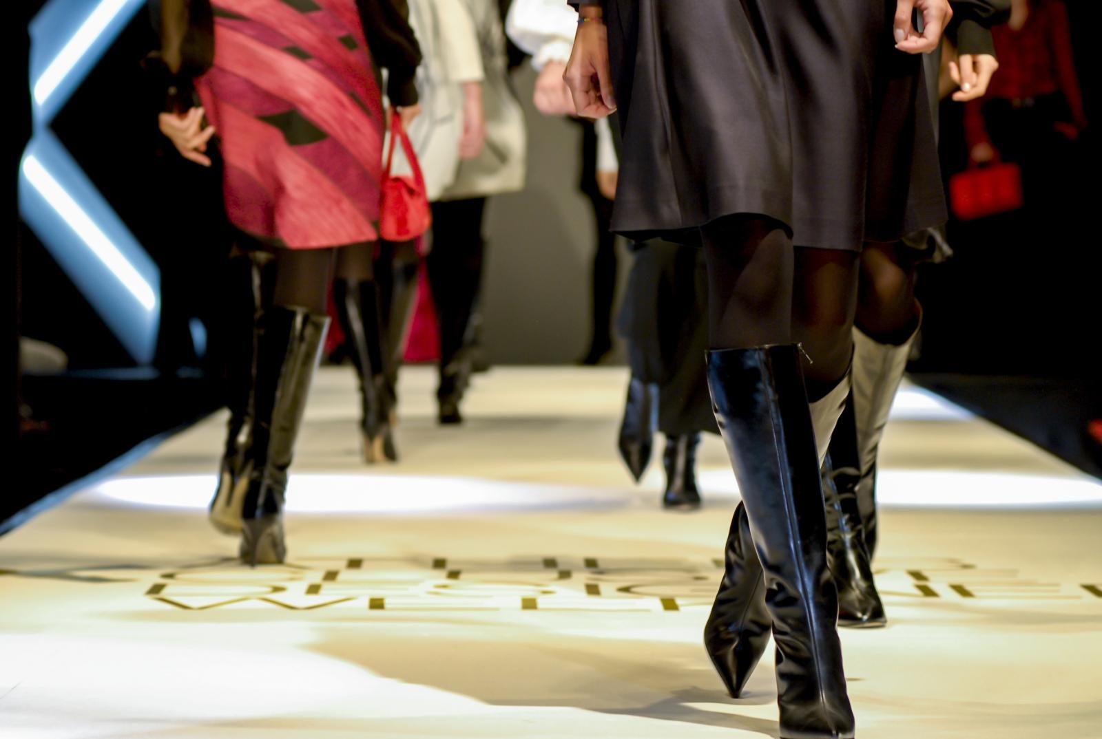 Models walking on a runway. Photo courtesy araelf/Fotolia.