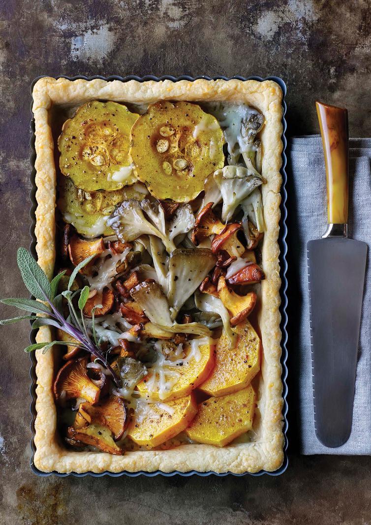 A pan of autumn mushroom & butternut tart.
