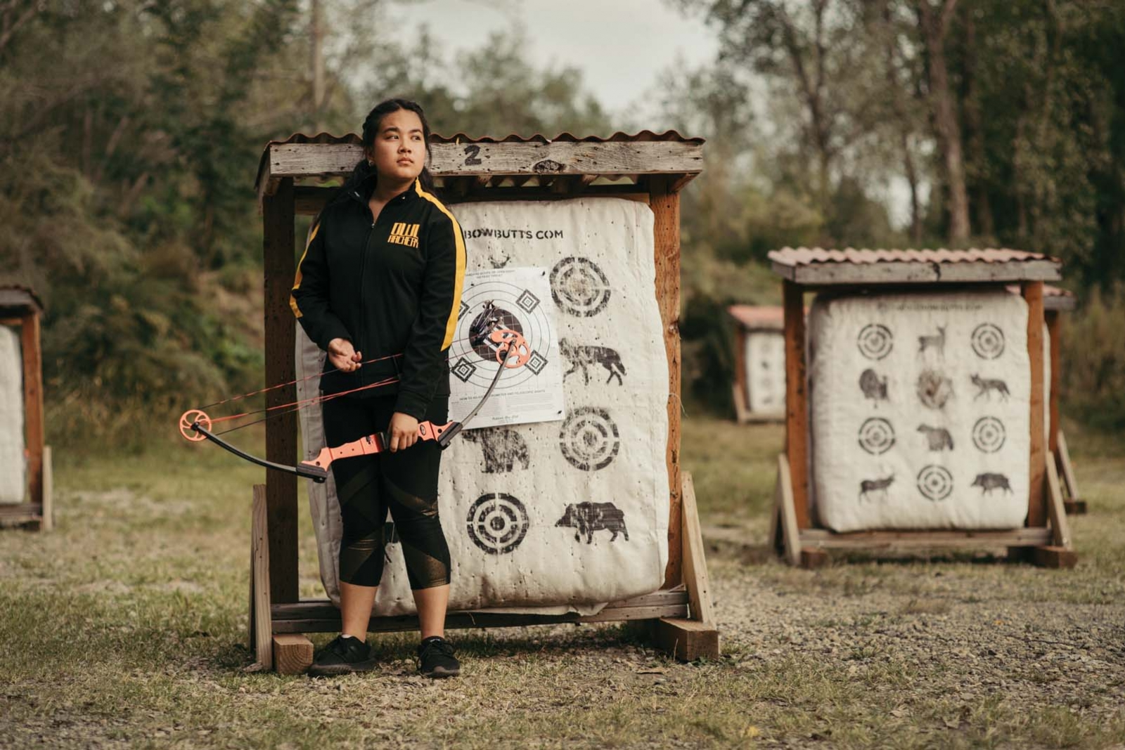 Emily Yang grips a compound bow at Pig's Eye Archery Range in St. Paul.