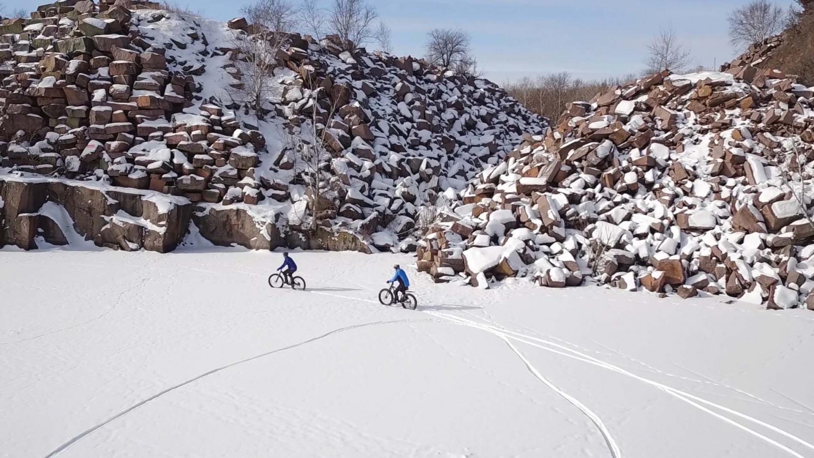 Two people fat biking at Quarry Park in St. Cloud, Minnesota.