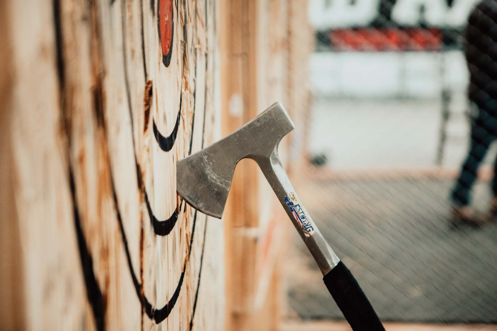 An axe stuck in a target at Bad Axe Throwing.