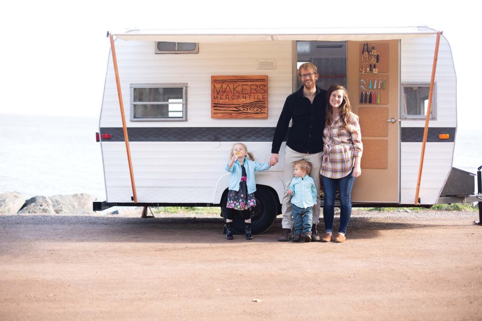 Makers Mercantile proprietors Sara and Scott Clifton outside a camper.