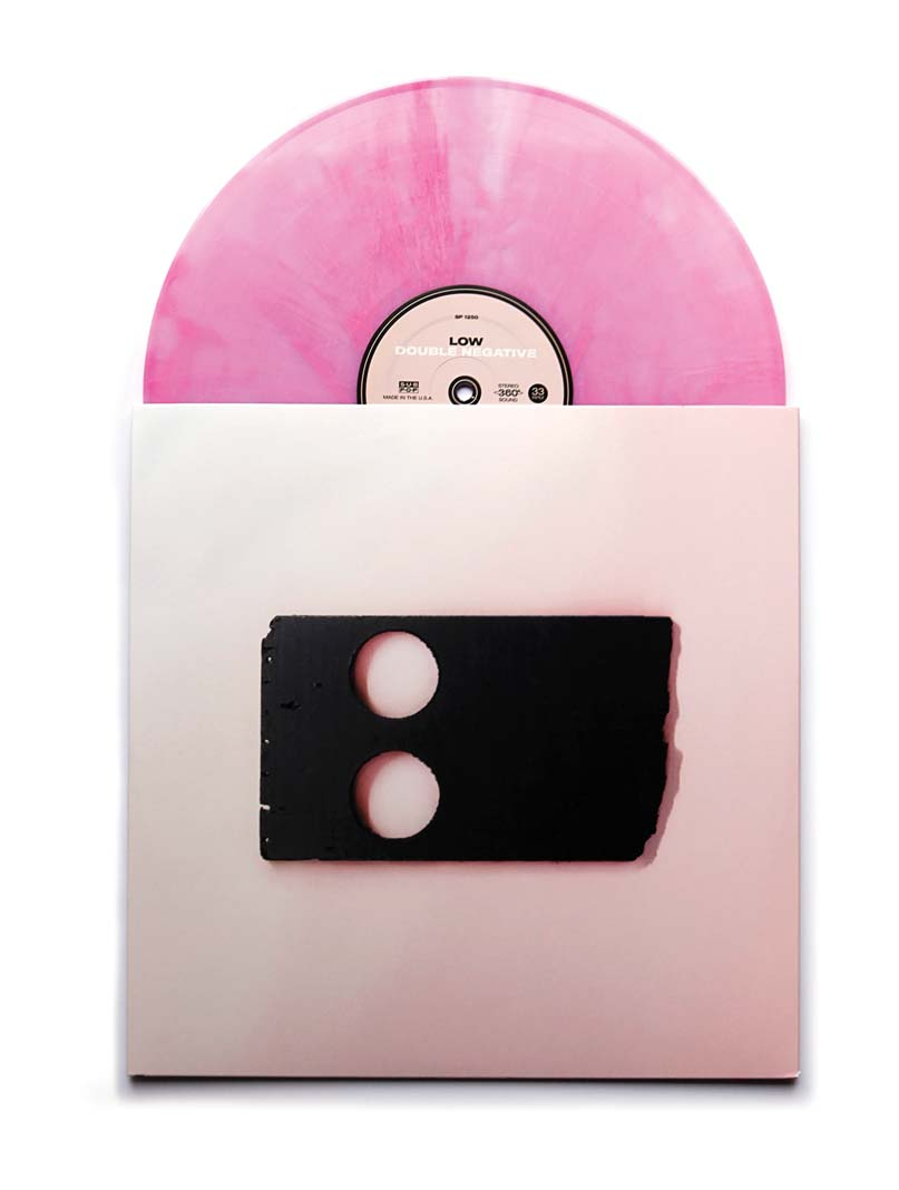 A pink record halfway out of its jacket.