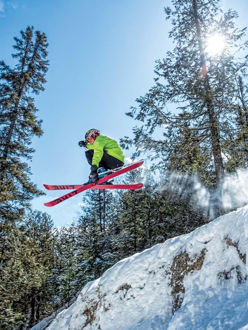 A skiier going off a jump at Lutsen Mountains.