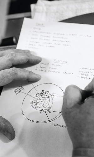 Chef Steven Brown of Tilia sketches a plate out
