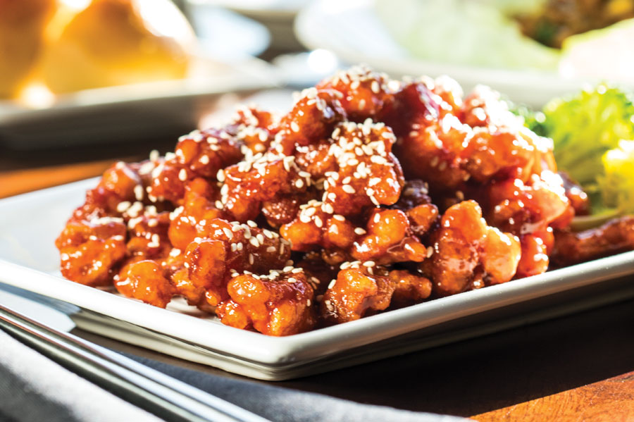A plate of sesame chicken at Jun in the North Loop in Minneapolis, Minnesota.