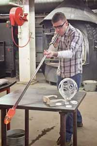 "Andy George of ""Ho to Make Everything"" blowing glass."