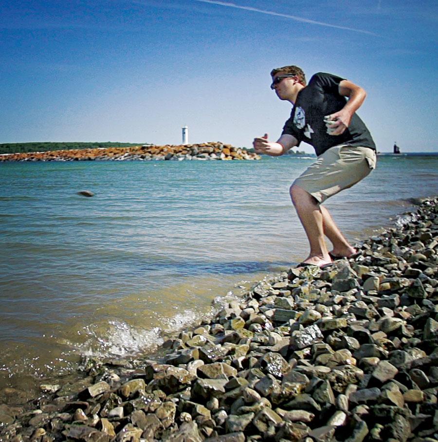 "Pro stone skipper Max ""Top Gun"" Steiner practicing at Mackinac Island."
