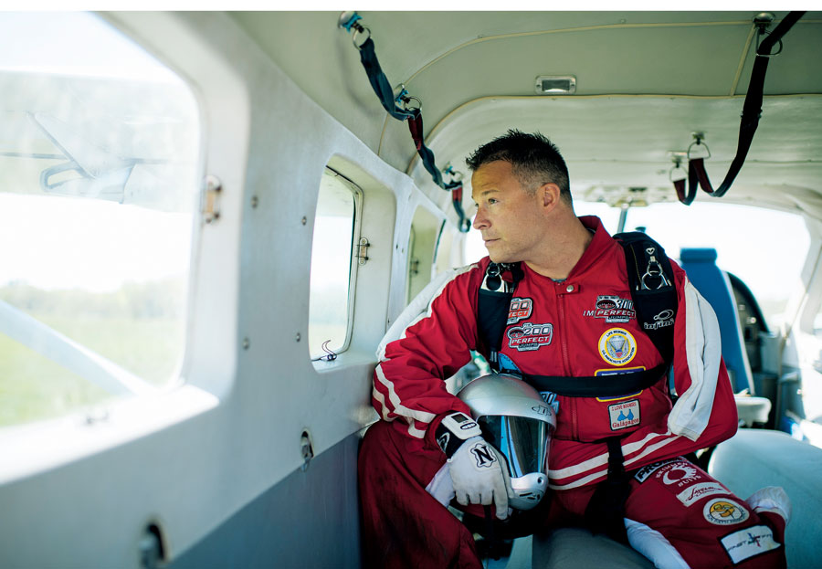 Kevin Burkhart sits on a plane before taking off for a skydive.