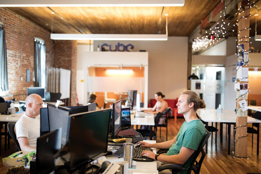 People working at the Collider co-working space in Rochester, Minnesota.