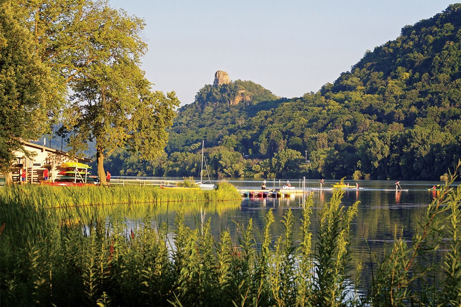 The limestone bluff known as Sugar Loaf overlooks the waterfront city of Winona, Minnesota.