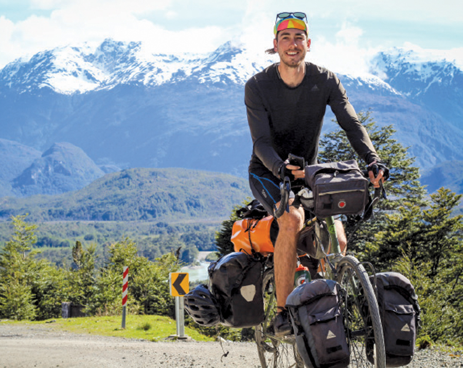 "Ian Anderson near Caleta Tortel, Chile, on the Carretera Austral highway during his ""Ride with Ian"" expedition."