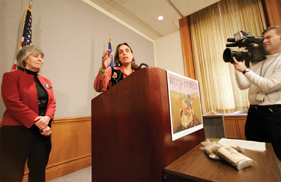 Winona LaDuke stands with DFL Representative Karen Clark at the Minnesota State Capitol in 2005, lobbying against the University of Minnesota's effort to genetically patent wild rice, a grass considered sacred to northern Minnesota tribes.
