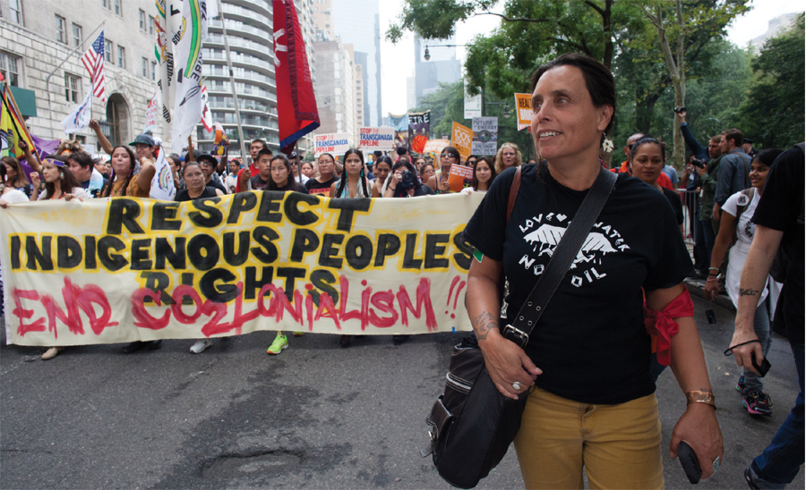 Winona LaDuke and other Native Americans lead nearly half a million people down the Avenue of the Americas in New York City as part of the People's Climate March in 2014, a large-scale activist event advocating for global action against climate change.