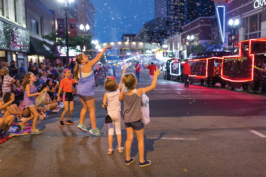Kids cheering at the parade during the Aquatennial in Minneapolis.