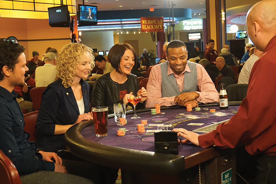 People playing blackjack at Running Aces Casino & Racetrack.