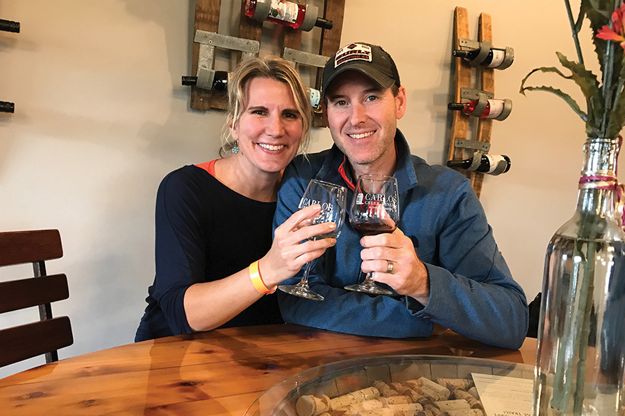 Chrissy and Aaron Sorenson sipping wine at Carlos Creek Winery in Alexandria, Minnesota.