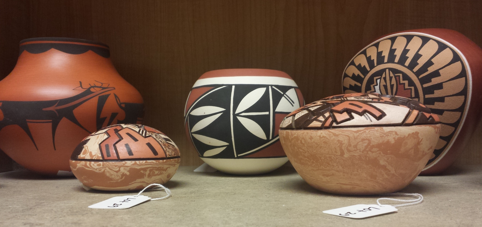 Some ceramics for sale at the June 23rd auction, Native American and Decorative Arts, put on by Revere Auctions. Photo by Lianna Matt