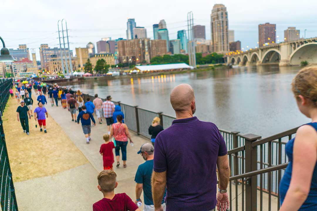 People attending the Stone Arch Bridge Festival in Minneapolis, Minnesota.