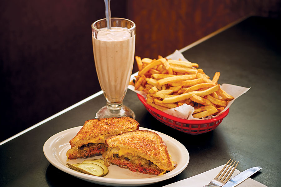 A patty melt, basket of fries, and chocolate shake at Convention Grill.