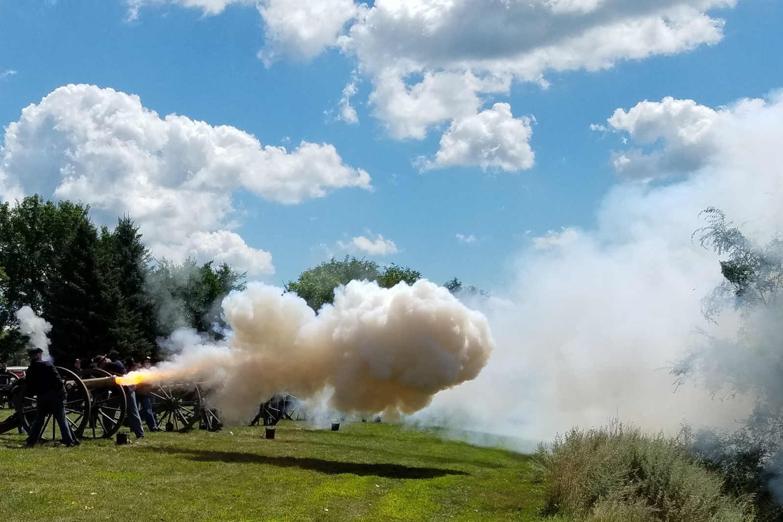 People firing a cannon at Pipestone Civil War Days.