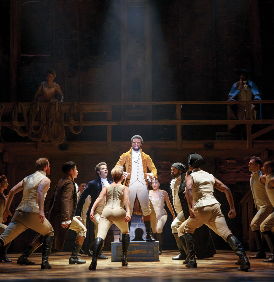 People on stage during a production of Hamilton.